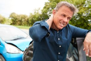 Mature Male Motorist With Whiplash Injury In Car Crash Getting Out Of Vehicle do i really need to hire a personal injury attorney