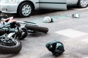 Overturned motorcycle after collision tips to prevent motorcycle accidents