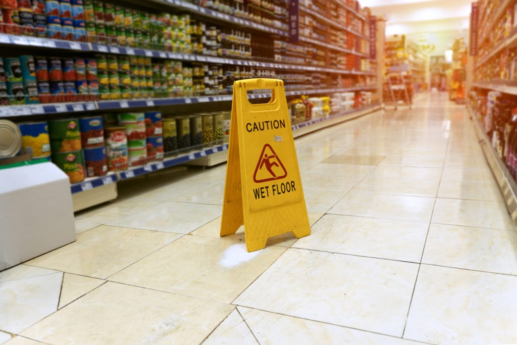 photo from slip fall lawyer of a wet floor sign in grocery store