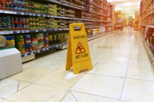 wet floor sign in a grocery store