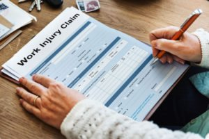 employee completing a work injury claim form